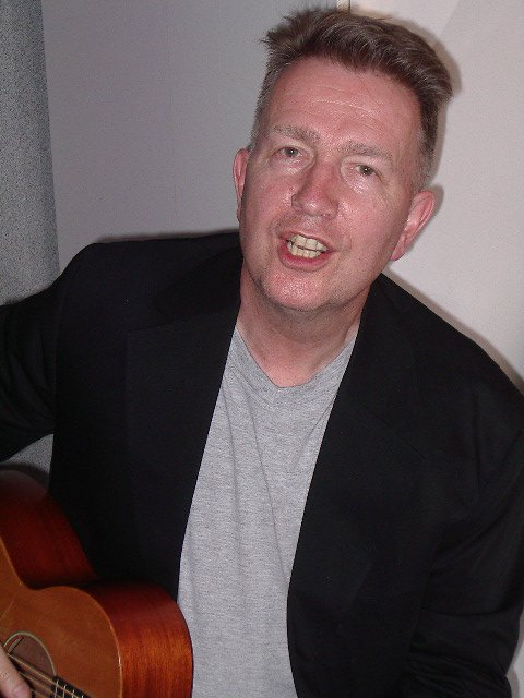 Tom Robinson, 6/11/04, photo by JD Doyle