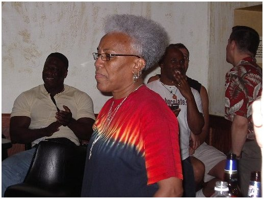 Gaye Adegbalola, and in the background you can spot Scot Free's lover (Dean), and Tori Fixx